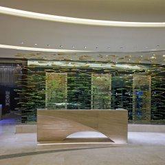 Отель Hilton Capital Grand Abu Dhabi ОАЭ, Абу-Даби - отзывы, цены и фото номеров - забронировать отель Hilton Capital Grand Abu Dhabi онлайн фитнесс-зал фото 2