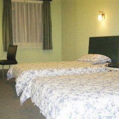 Отель Motel 168 Luo Fang Inn Шэньчжэнь удобства в номере