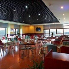 Отель Home Inn (Hangzhou Binwen Road Baimahu University City) гостиничный бар