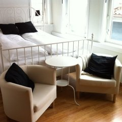 Апартаменты Bergen Apartments Берген комната для гостей фото 2