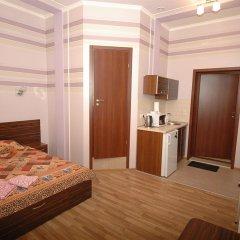 Апартаменты Malon Apartments комната для гостей