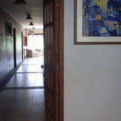 Отель Alfonso Hotel Филиппины, Тагайтай - отзывы, цены и фото номеров - забронировать отель Alfonso Hotel онлайн интерьер отеля фото 3