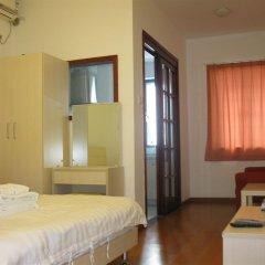 Отель Private-Enjoyed Home-ShangDe Apartment Китай, Гуанчжоу - отзывы, цены и фото номеров - забронировать отель Private-Enjoyed Home-ShangDe Apartment онлайн комната для гостей