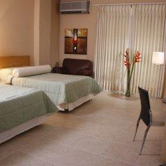 Отель Miami Inn Колумбия, Кали - отзывы, цены и фото номеров - забронировать отель Miami Inn онлайн комната для гостей