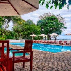Отель Nuwarawewa Rest House Шри-Ланка, Анурадхапура - отзывы, цены и фото номеров - забронировать отель Nuwarawewa Rest House онлайн бассейн фото 2