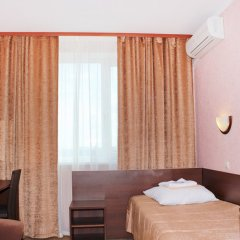 Гостиница Изумруд Север комната для гостей фото 7