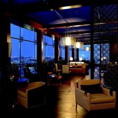 Отель The Ritz-Carlton Abu Dhabi, Grand Canal гостиничный бар фото 3