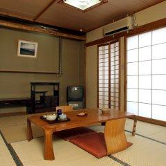 Отель Aso Uchinomaki Onsen Kintoki Минамиогуни комната для гостей фото 2