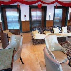 Golden Peak Hotel & Suites комната для гостей фото 10
