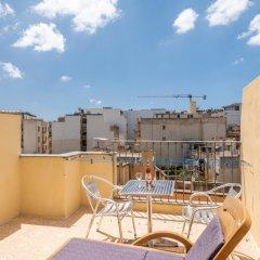 Отель Spinola Bay Penthouse Мальта, Сан Джулианс - отзывы, цены и фото номеров - забронировать отель Spinola Bay Penthouse онлайн балкон фото 4