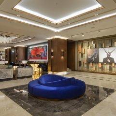 Hilton Istanbul Maslak Турция, Стамбул - отзывы, цены и фото номеров - забронировать отель Hilton Istanbul Maslak онлайн интерьер отеля