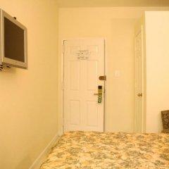 Отель Americana Inn 2* Кровать в общем номере с двухъярусной кроватью