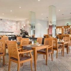 Отель Ramada by Wyndham München Airport Германия, Мюнхен - отзывы, цены и фото номеров - забронировать отель Ramada by Wyndham München Airport онлайн гостиничный бар