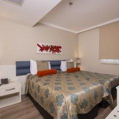 Orange County Resort Hotel Kemer - All Inclusive 5* Стандартный семейный номер с различными типами кроватей фото 2