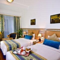 Landmark Plaza Hotel комната для гостей