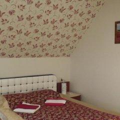 Гостевой дом Три клена комната для гостей фото 6