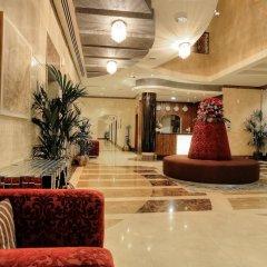 One to One Clover Hotel & Suites интерьер отеля