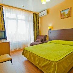 Гостиница Ателика Гранд Меридиан комната для гостей