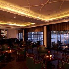 Отель Country Inn & Suites By Carlson, Satbari, New Delhi Индия, Нью-Дели - отзывы, цены и фото номеров - забронировать отель Country Inn & Suites By Carlson, Satbari, New Delhi онлайн гостиничный бар