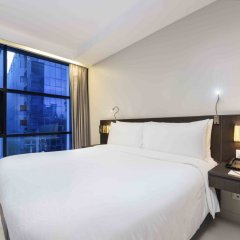 Отель Maitria Sukhumvit 18 Bangkok – A Chatrium Collection 4* Стандартный номер фото 3