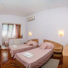 Гостиница Муссон Стандартный семейный номер с 2 отдельными кроватями