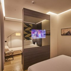 Отель IH Hotels Milano Ambasciatori 4* Номер Делюкс с различными типами кроватей фото 3