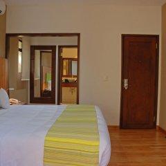 Отель Country Inn & Suites by Radisson, San Jose Aeropuerto, Costa Rica комната для гостей фото 8