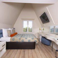 Orange County Resort Hotel Kemer - All Inclusive 5* Стандартный семейный номер с различными типами кроватей фото 4