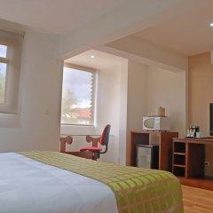 Отель Country Inn & Suites by Radisson, San Jose Aeropuerto, Costa Rica удобства в номере