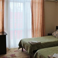 Гостевой Дом Лидер комната для гостей фото 3