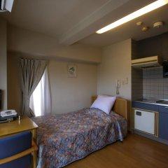 Отель Weekly Inn Minami Fukuoka Фукуока комната для гостей фото 2