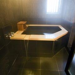 Отель Tokunoyado Fubuan Беппу ванная фото 2