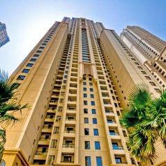 Отель Vacation Holiday Homes - Jumeirah Beach Residences вид на фасад