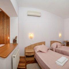 Гостиница Муссон Стандартный семейный номер с различными типами кроватей фото 2