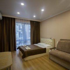 Апартаменты Мадрид Парк 2 комната для гостей фото 3