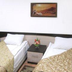 Гостиница Столичная комната для гостей фото 6