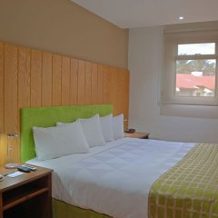 Отель Country Inn & Suites by Radisson, San Jose Aeropuerto, Costa Rica комната для гостей фото 5