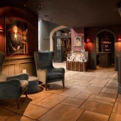 Отель De Orangerie - Small Luxury Hotels of the World Бельгия, Брюгге - отзывы, цены и фото номеров - забронировать отель De Orangerie - Small Luxury Hotels of the World онлайн гостиничный бар фото 2