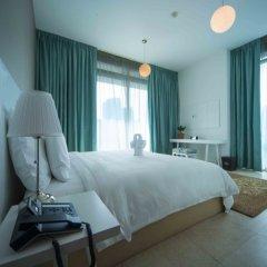 Отель Jannah Marina Bay Suites Люкс с различными типами кроватей