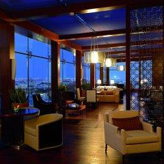 Отель The Ritz-Carlton Abu Dhabi, Grand Canal гостиничный бар фото 2