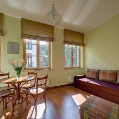 Отель Odminiu Square Apartment Литва, Вильнюс - отзывы, цены и фото номеров - забронировать отель Odminiu Square Apartment онлайн комната для гостей