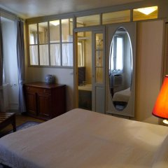 Отель Hôtel Les Degrés De Notre Dame Париж комната для гостей фото 4