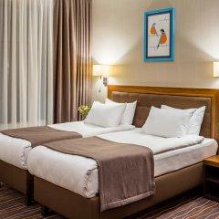 Гостиница Taurus City Львов комната для гостей фото 5