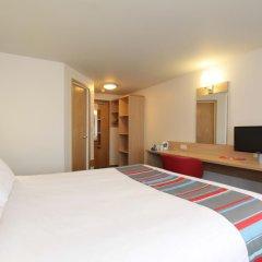 Отель Travelodge Ashton Under Lyne комната для гостей фото 4