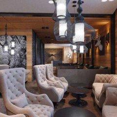 Гостиница Arkhyz Royal Resort & Spa в Архызе отзывы, цены и фото номеров - забронировать гостиницу Arkhyz Royal Resort & Spa онлайн Архыз интерьер отеля фото 2