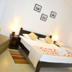 Отель Nuwarawewa Rest House Шри-Ланка, Анурадхапура - отзывы, цены и фото номеров - забронировать отель Nuwarawewa Rest House онлайн комната для гостей
