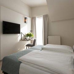 Отель Martins Brugge 3* Семейный номер Charming с различными типами кроватей фото 2