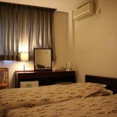 Отель Travel Inn Yoshitomi Минамиогуни удобства в номере