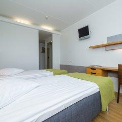 GO Hotel Snelli комната для гостей