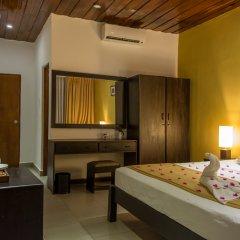 Отель Nuwarawewa Rest House Шри-Ланка, Анурадхапура - отзывы, цены и фото номеров - забронировать отель Nuwarawewa Rest House онлайн сейф в номере
